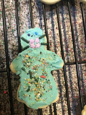 We love baking and silliness.  This  cookie is all masked up to be eaten!