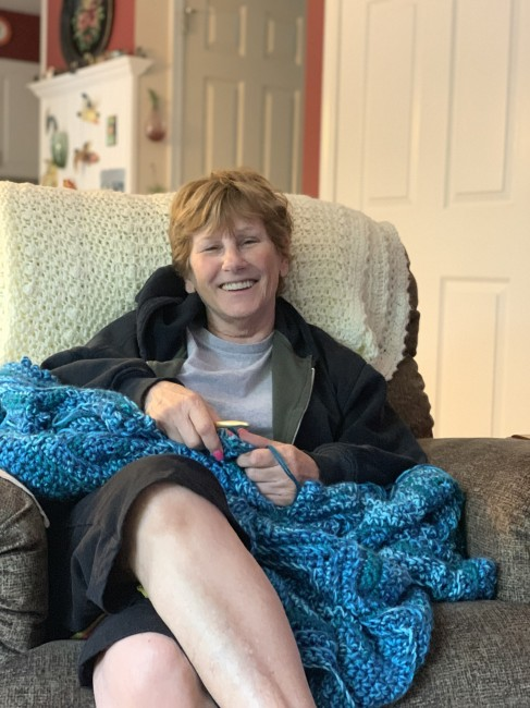 Matt's mom crocheting . She makes the most amazing blankets, and even taught Amy!