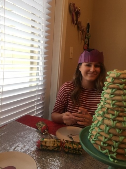 Meaghan's sister-in-law wearing her crown from the Christmas cracker while posing with the krunsekake.