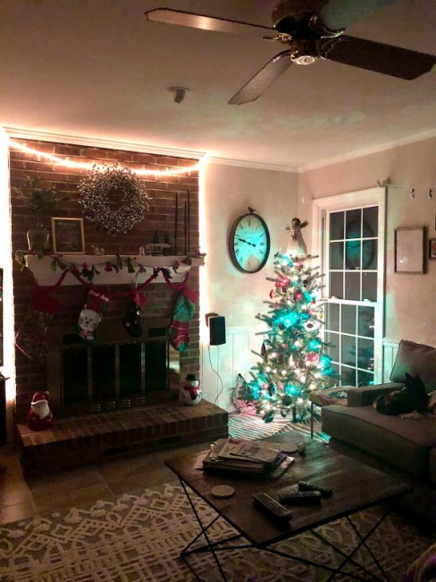 Each year, we put up two Christmas trees. This is in our back living room where we also hang  our 4 stockings. We can't wait to add one more little stocking to the mantle :)