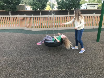 Getting dizzy on the tire swing!