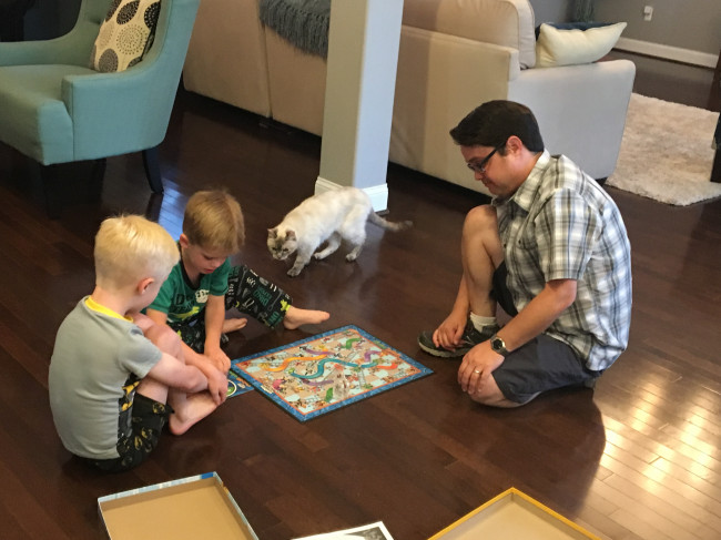 Clay's nephews (with the help of their kitty) teach him one of their favorite board games.