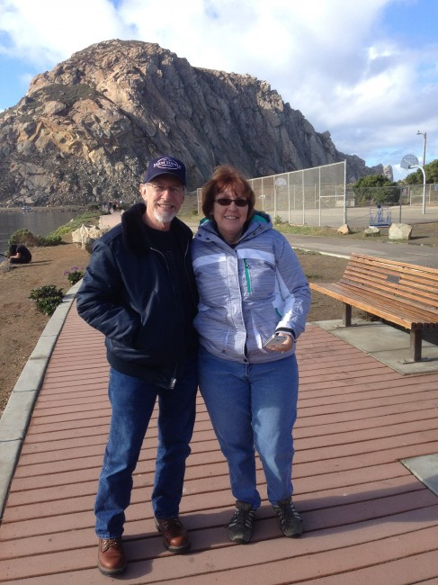 Laura's parents pose in front of Morro Rock.