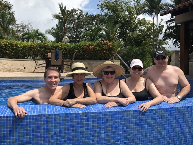Clay's uncle, mother, family member, sister, and brother-in-law enjoy a day at the pool.