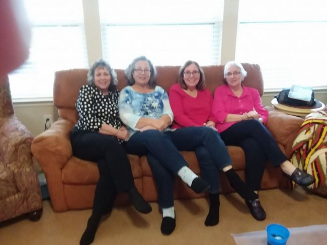 Laura's mother poses with her three sisters at a family gathering.