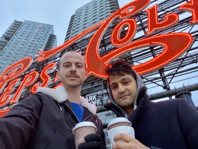 We love our local shops. Marc and Dev drinking coffee during a NYC walk, next to our new home in Queens.