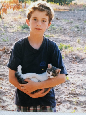 We love animals. Here is Marc holding a cat when he was a kid.